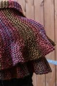 Knitted shawl with ruffled edge